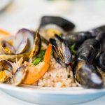 Le risotto alla pescatora, une recette raffinée, à base de mollusques et crustacés
